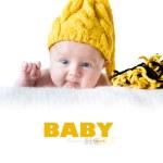 Newborn girl in yellow cap — Stock Photo