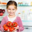 Girl with tomatos — Stock Photo #18551815