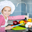 Little girl preparing healthy food — Stock Photo #18551851