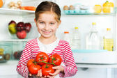 Girl with tomatos — Stock Photo