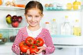 Girl with tomatos — Stock Photo