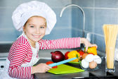 Little girl preparing healthy food — Stock Photo