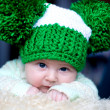 Newborn girl in a green hat — Stock Photo