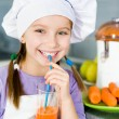 Stock Photo: Girl making fresh juice
