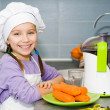Girl  making fresh juice - Stock Photo