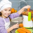Girl making fresh juice — Stock Photo #18932671