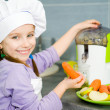 Girl making fresh juice — Stock Photo #18932673