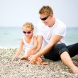 Stock Photo: Father and his daughter on the beach