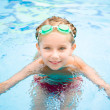 Stock Photo: Little girl in swimming pool
