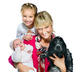 Pretty young woman with her daughters and dog — Stock Photo