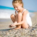 Little girl on the beach — Stock Photo #18961949