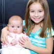 Little girl and her newborn sister — Stock Photo