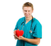 Male doctor with a heart in his hands — Stock Photo