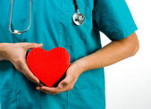 Doctor holding a heart symbol — Stock Photo