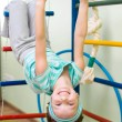 Little girl at gymnastic rings - Stock Photo