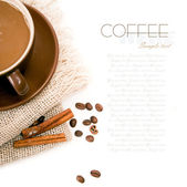 Ceramic cup of coffee with cinnamon — Stock Photo