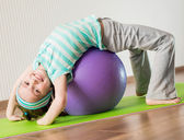 Little girl doing gymnastic exercises — Stock Photo
