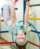 Little girl at gymnastic rings — Stock Photo