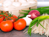 Fresh raw vegetables and rice noodles — Stock Photo