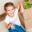 Little girl moving into new house — Stock Photo