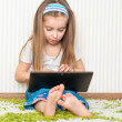 Little girl with a laptop - Stok fotoğraf