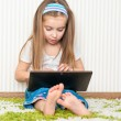 Little girl with a laptop - Stock Photo