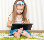 Little girl with a laptop — Stock Photo