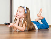 Girl holding a remote control — Stock Photo