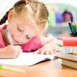 Stock Photo: Little girl is writing