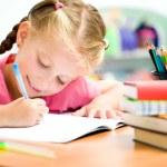 Little girl is writing — Stock Photo