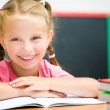 Ittle girl with the books — Stock Photo
