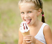 Little girl with ice-cream — Stock Photo
