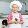 Little girl on the kitchen - Stock Photo