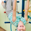 Little girl at gymnastic rings — Stock Photo #22616489