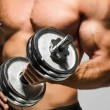 Man working out with dumbbells - Stock Photo