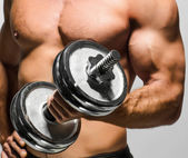 Man working out with dumbbells — Stok fotoğraf