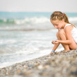 Little girl on the beach — Stock Photo