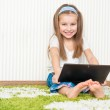 Little girl with a laptop — Stock Photo #22630643