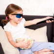 Little girl watching TV — Stockfoto