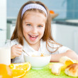 Little girl eating her breakfast — Stock Photo #23525491