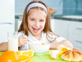 Little girl eating her breakfast — Stock Photo