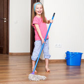 Little girl washing the floor — Stock Photo