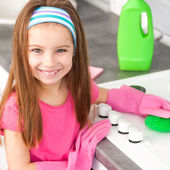 Girl make cleaning in the kitchen — Stock Photo