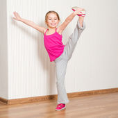 Little girl engaged in fitness — Stock Photo
