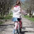 Little girl on her bike - Stockfoto