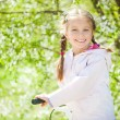 Little girl on her bike — Stock Photo #24611799