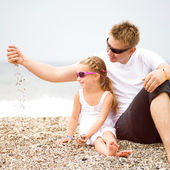 Father and his daughter on the beach — Stock Photo
