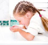 Girl washing in bath — Stock Photo