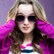 Little fashion model in sunglasses — Stockfoto