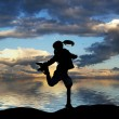 Silhouette of a little girl jumping — Stock Photo